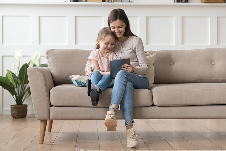 a woman and a child sitting on a couch