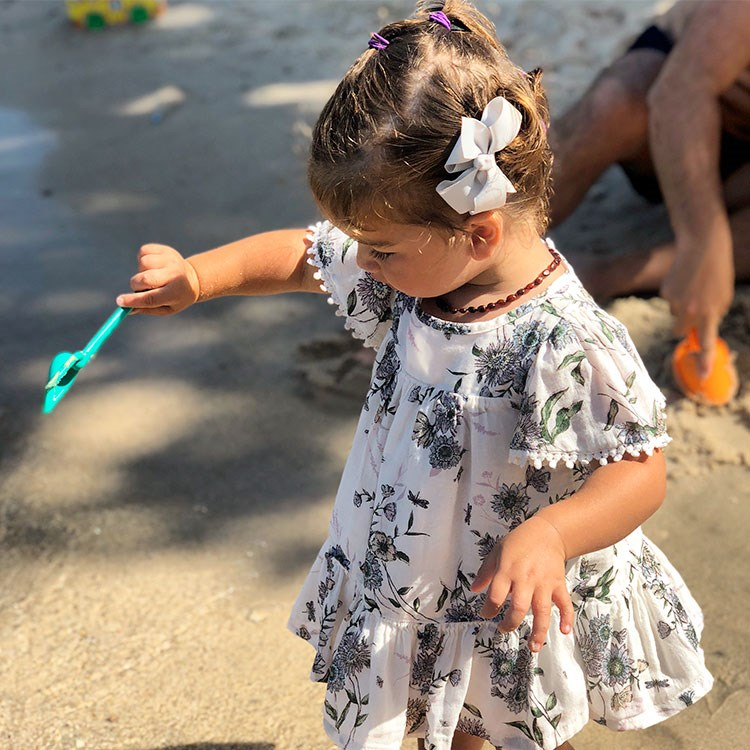 a little girl holding a toy