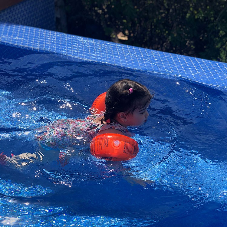 a person in a pool with a ball