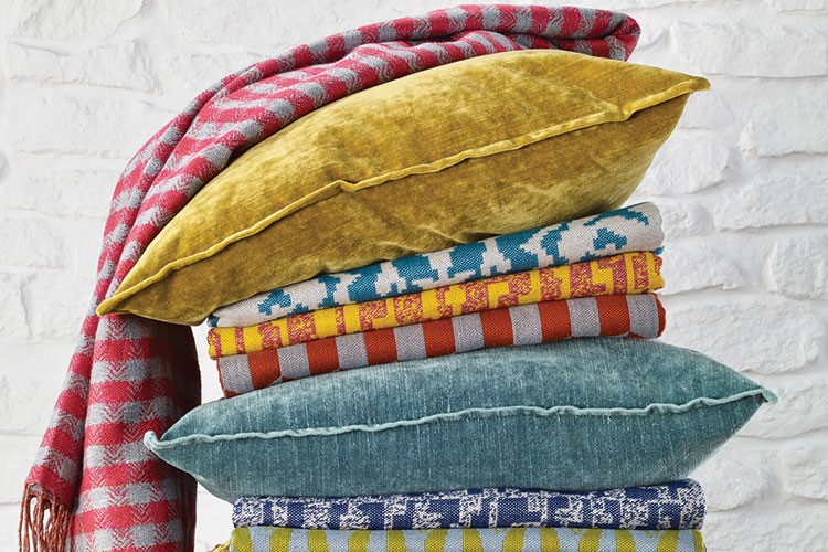 a colorful striped pillow
