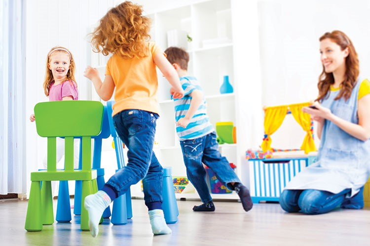 a group of children playing in a room