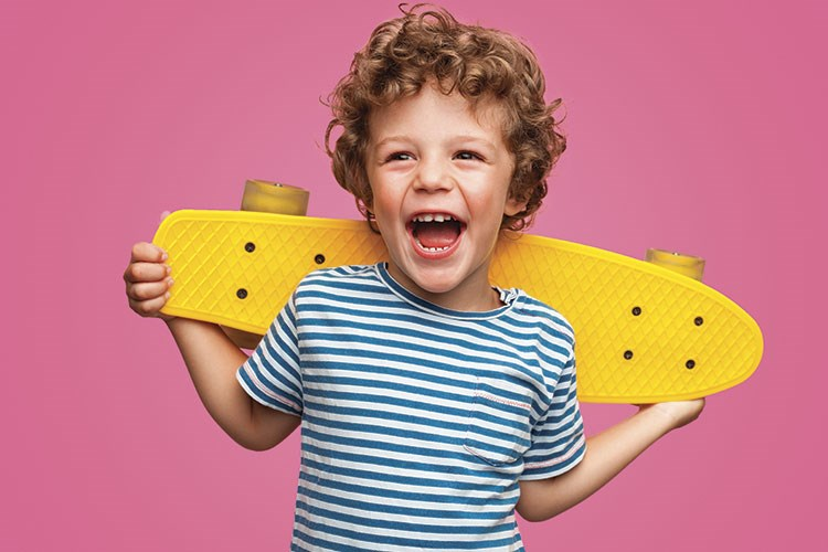 a child holding a yellow toy