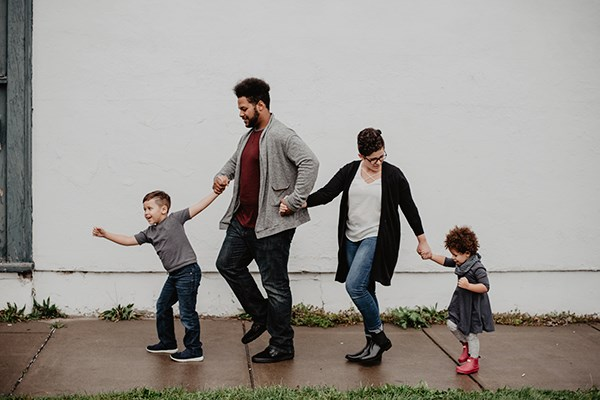 a man and woman walking with children