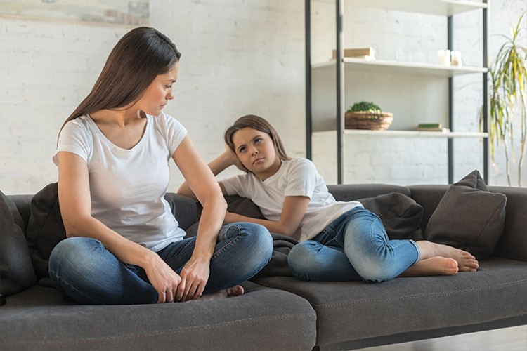 a couple of women sitting on a couch