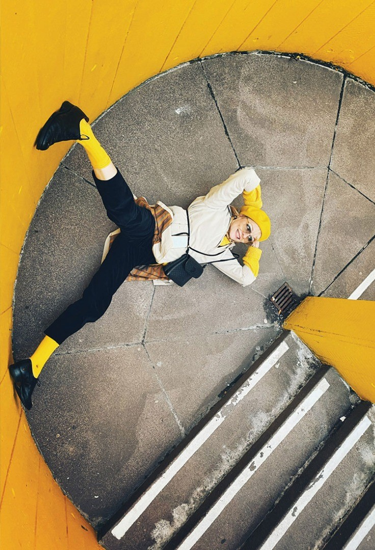a person in a yellow jacket on a yellow and black trampoline
