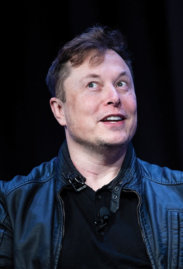 Elon Musk with a surprised expression