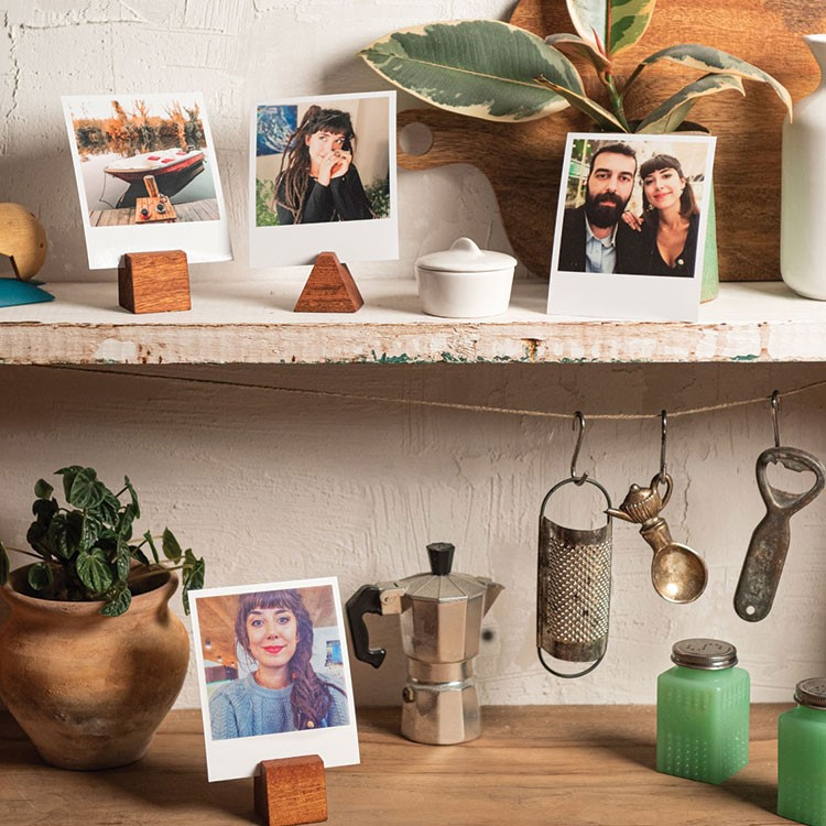 a shelf with pictures and cooking utensils on it