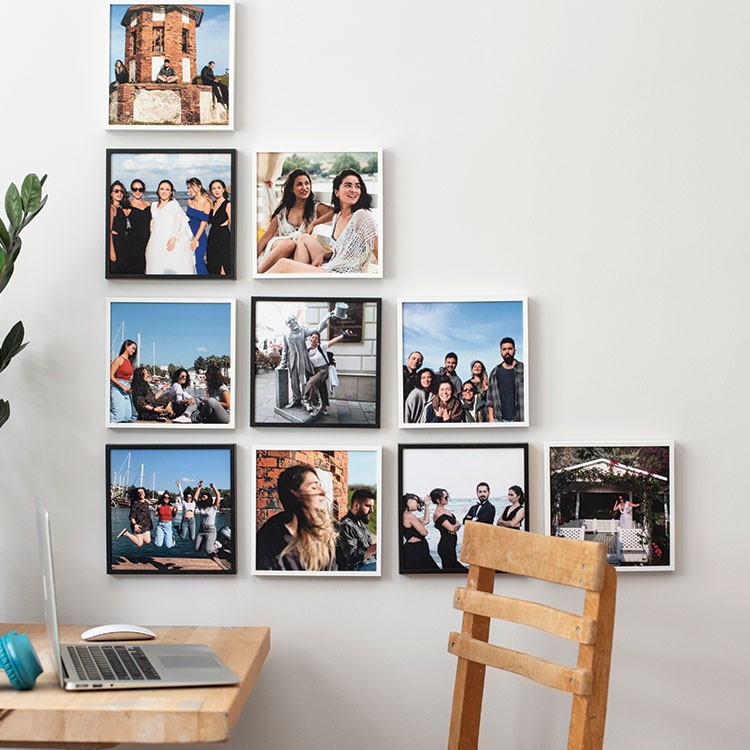 a wall with pictures on it