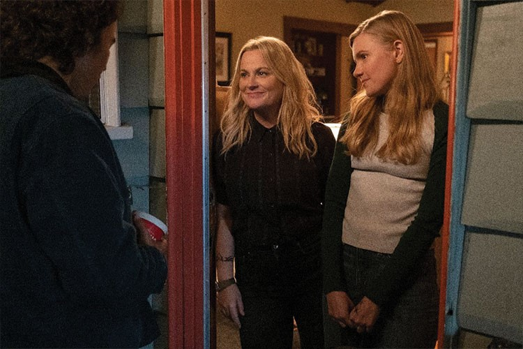 Amy Poehler looking at another woman