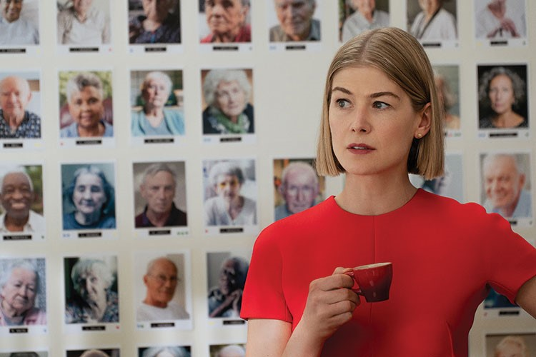 Rosamund Pike holding a cup
