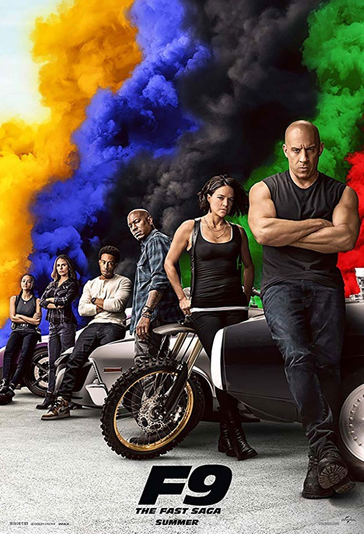 Vin Diesel et al. sitting in a wheelchair in front of a painting