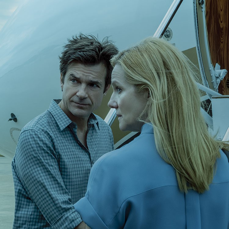 Jason Bateman and woman looking at each other