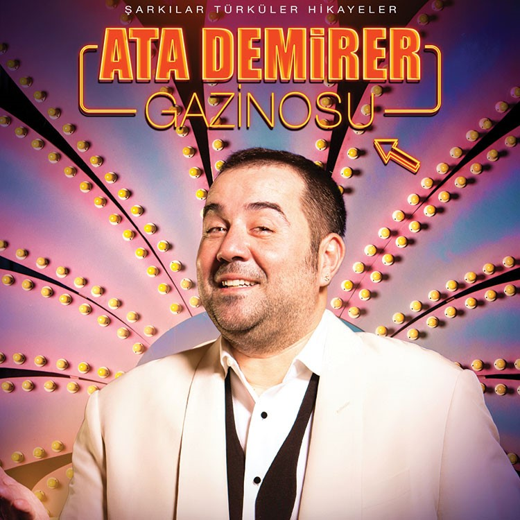 Ata Demirer in a white suit