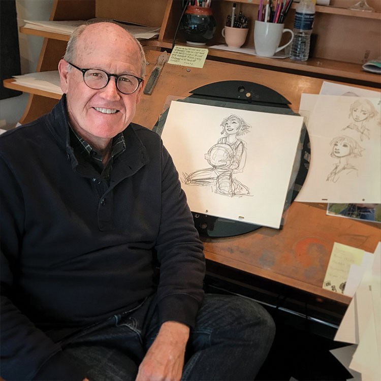 a man sitting at a desk with a drawing on it