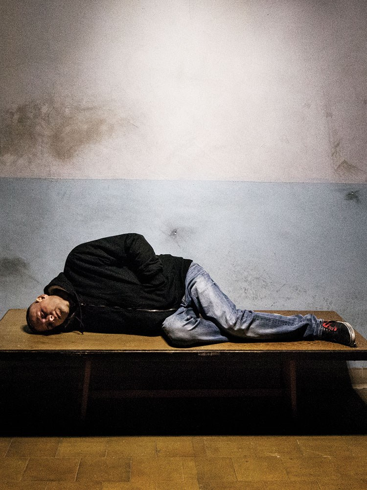 a person lying on a bench