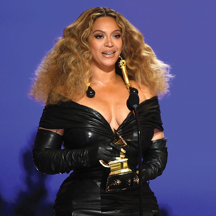 Beyonce wearing a black leather jacket and black gloves