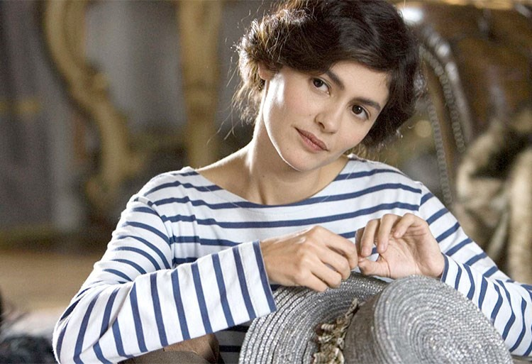 Audrey Tautou with a headset on