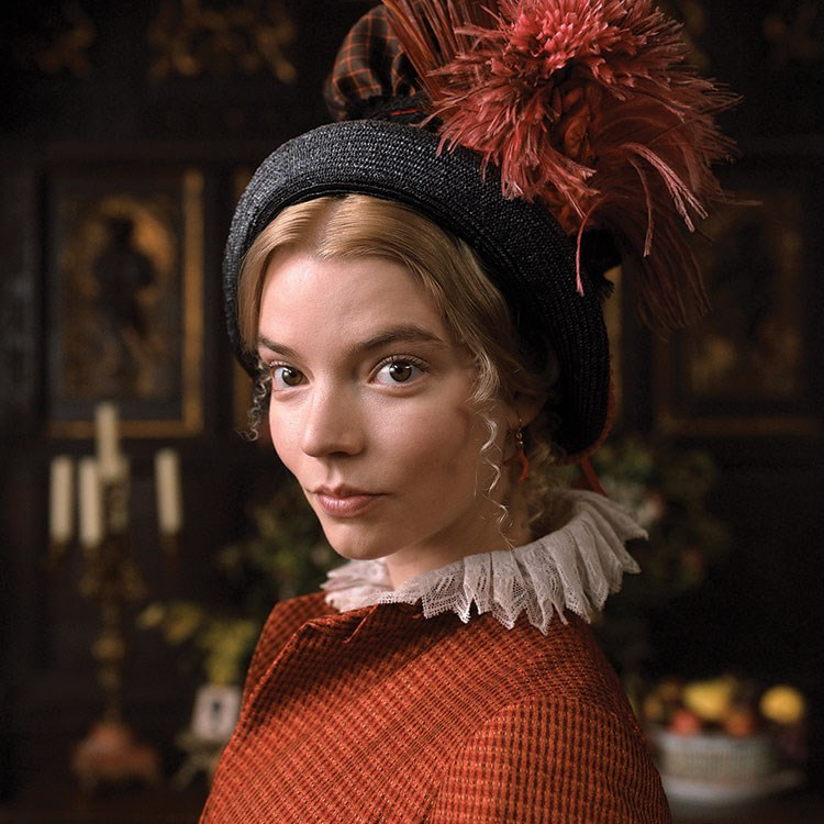 Anya Taylor-Joy with a red flower on the head