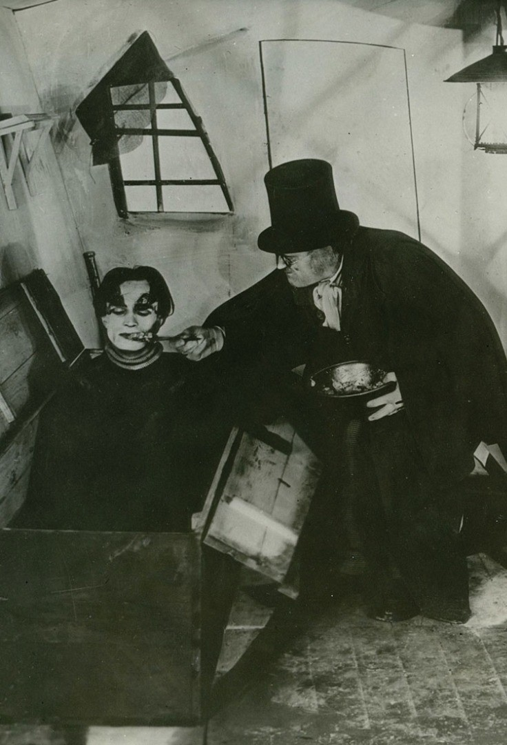 a person and a child in a small room