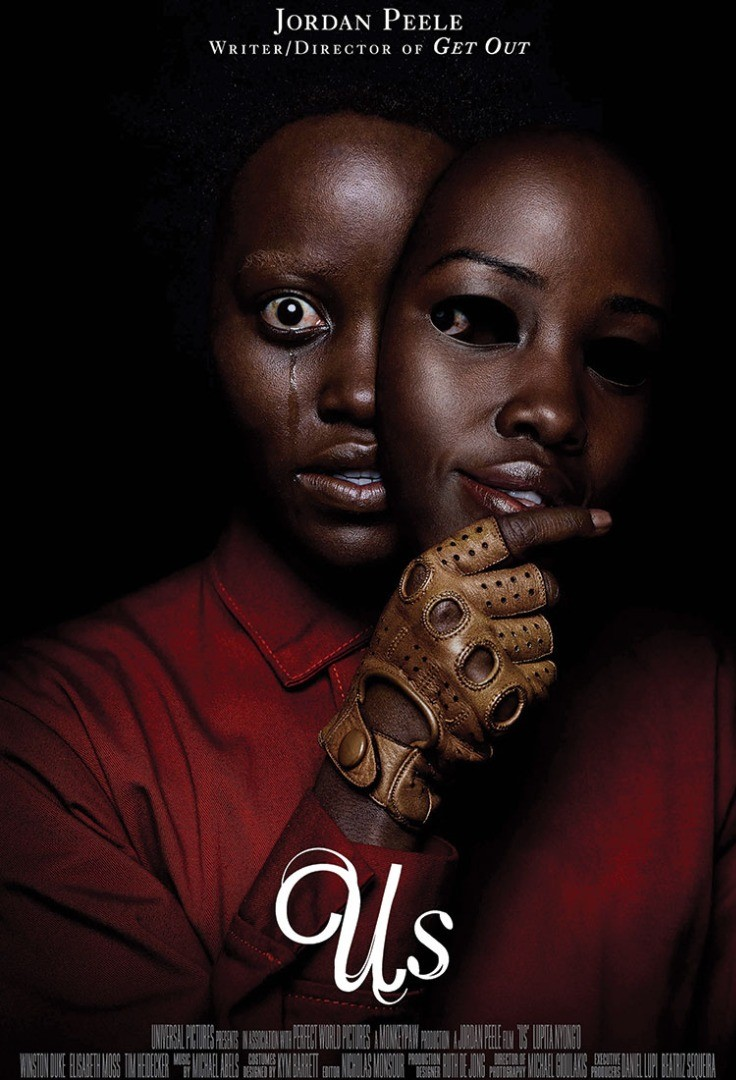 Lupita Nyong'o with her hand on her chin and a man with a red shirt