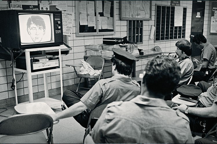 a group of people watching a television