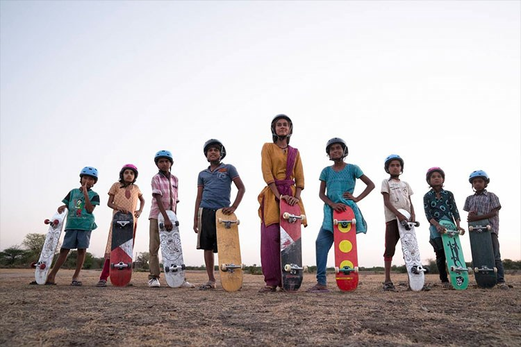 a group of people holding skateboards