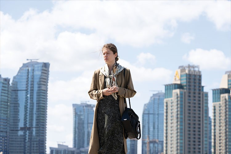 a person standing in front of a city skyline