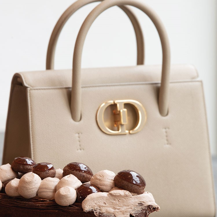 a white purse with a gold handle