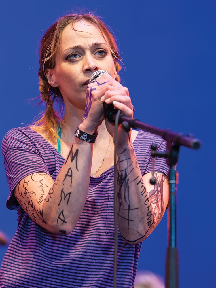 Fiona Apple singing into a microphone