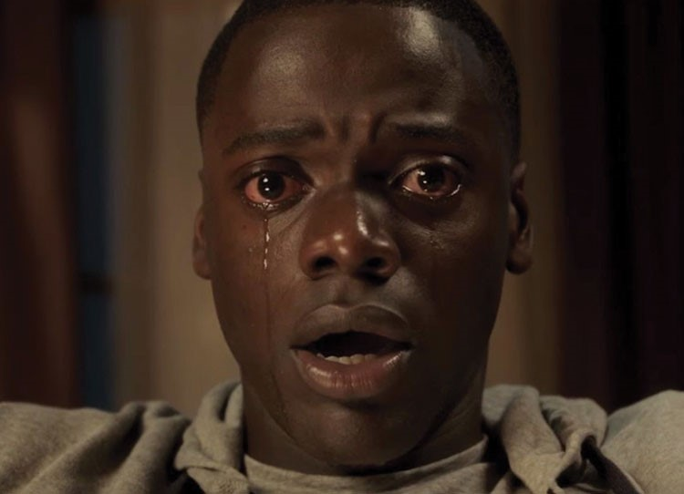 Daniel Kaluuya with his mouth open