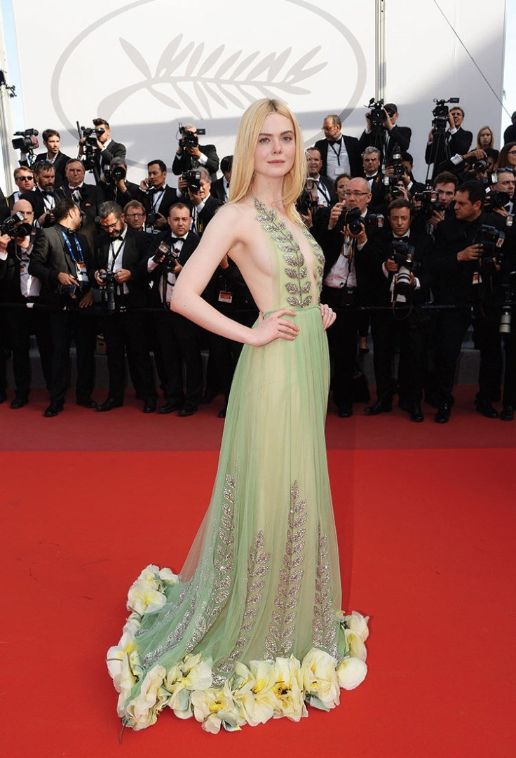 Elle Fanning in a dress in front of a large group of people