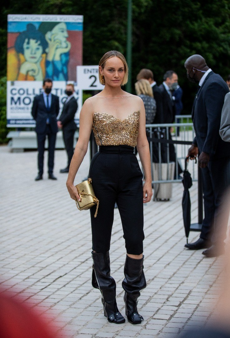 Amber Valletta in a leather outfit