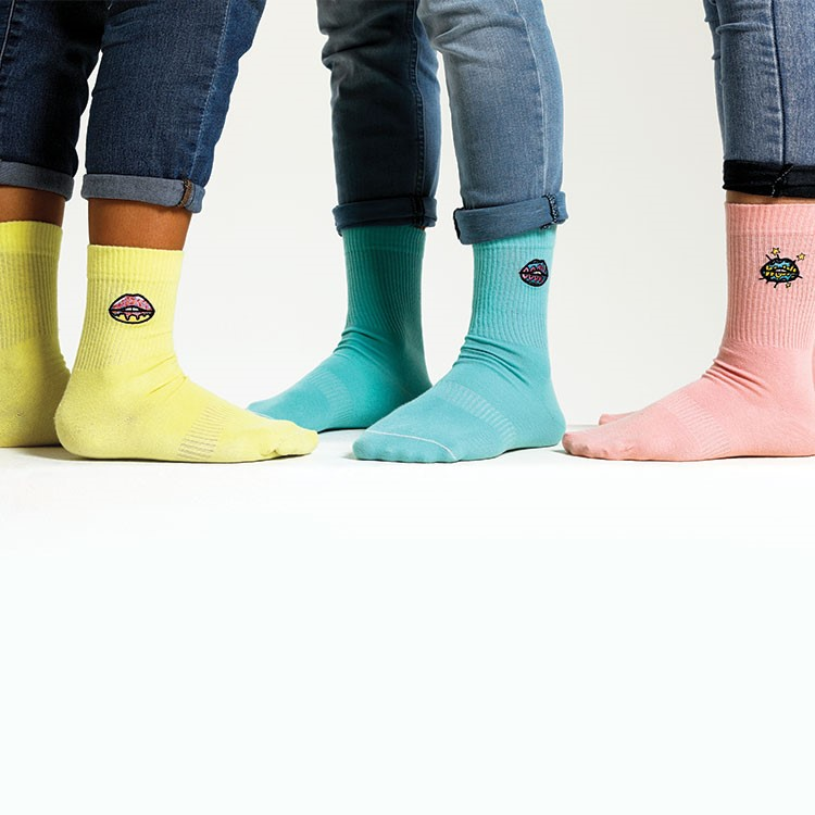 a group of people wearing colorful socks