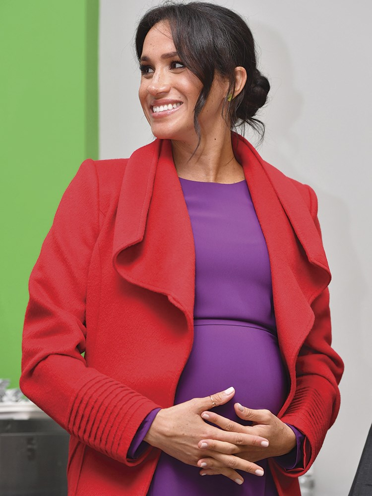 Meghan Markle in a red suit