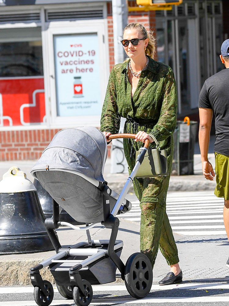 a person pushing a stroller