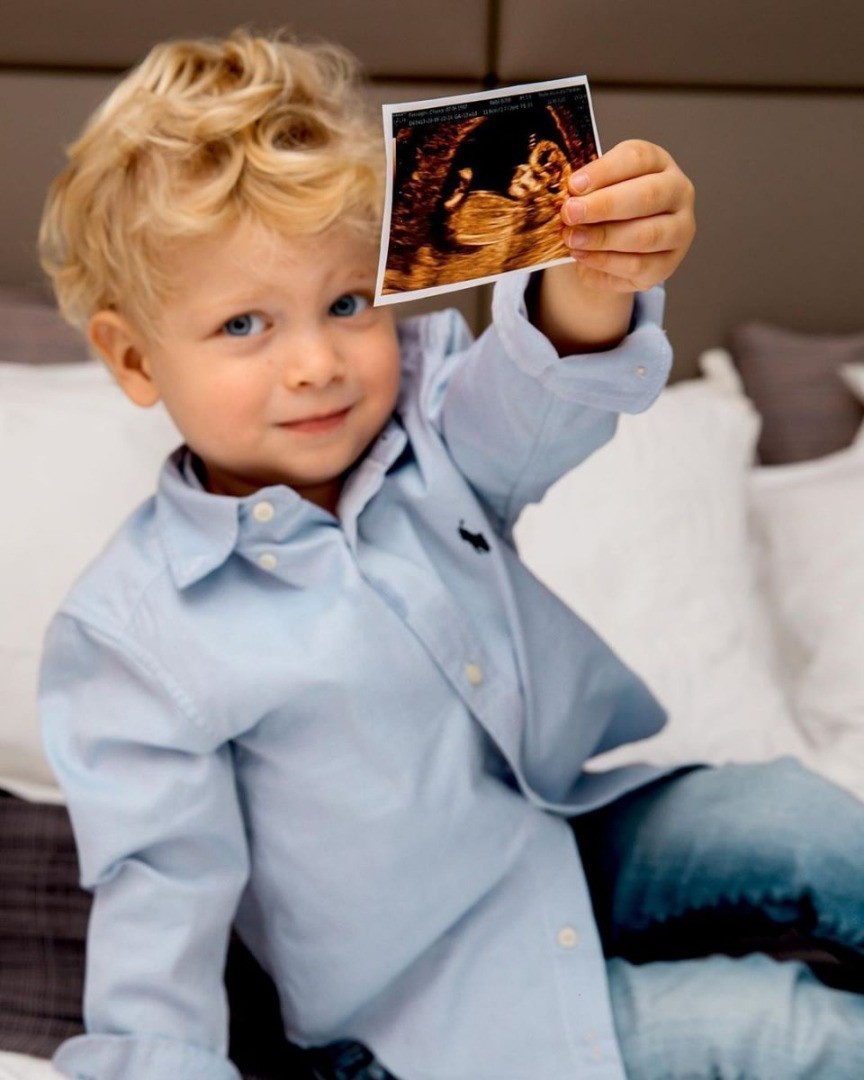 a boy holding a picture