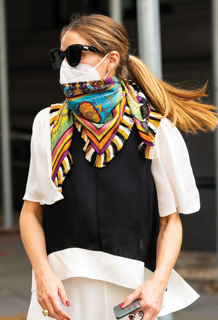 a woman wearing a scarf and sunglasses