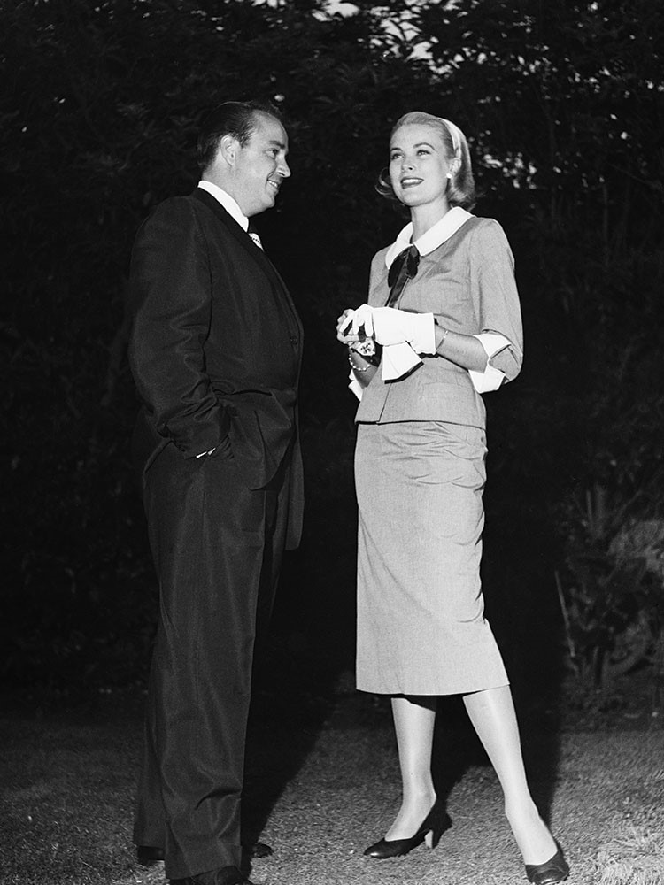 Grace Kelly and woman standing next to each other and smiling