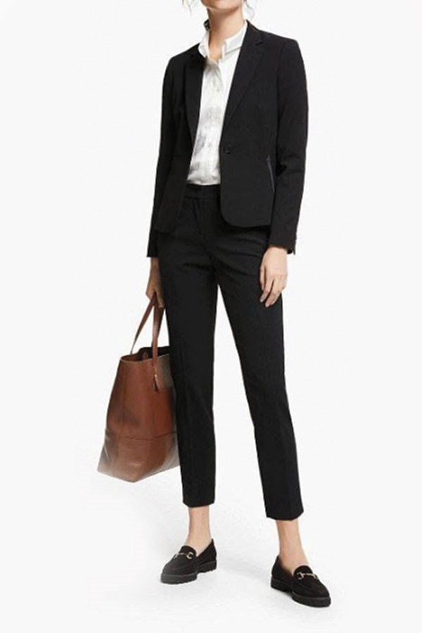 a man in a suit holding a purse