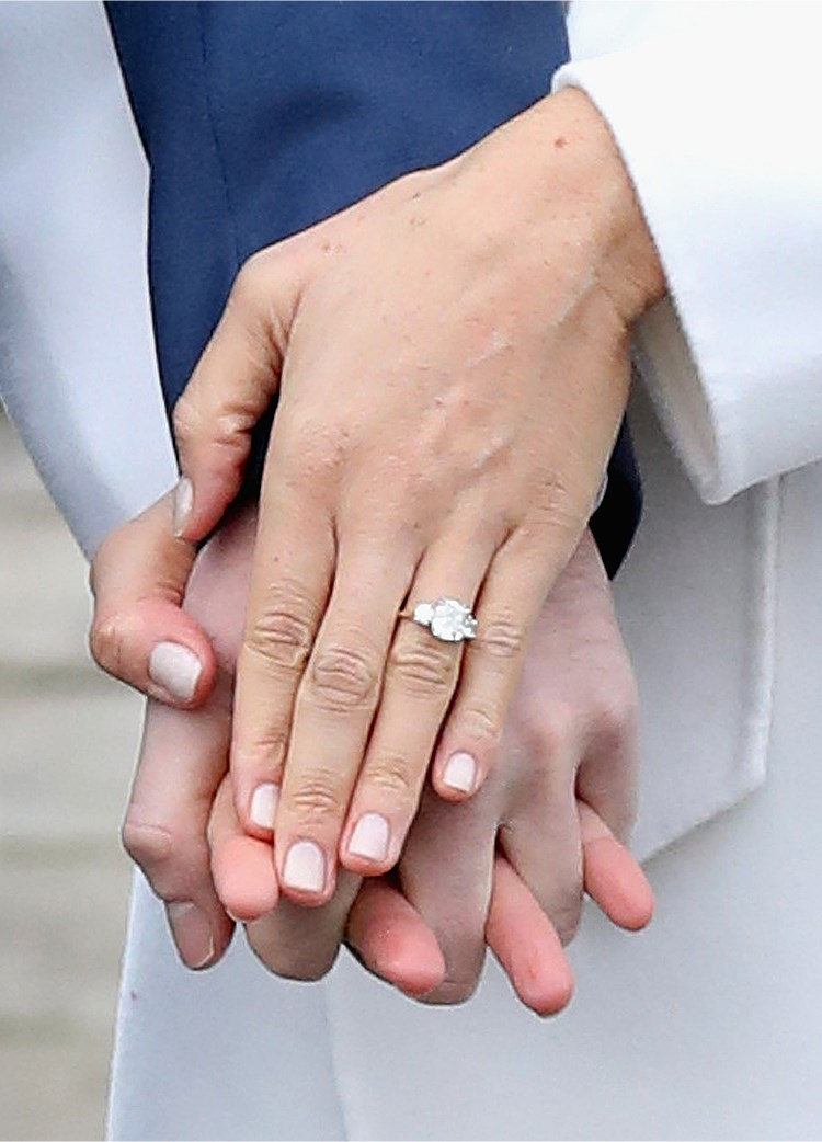 a woman's hand with a ring on her finger