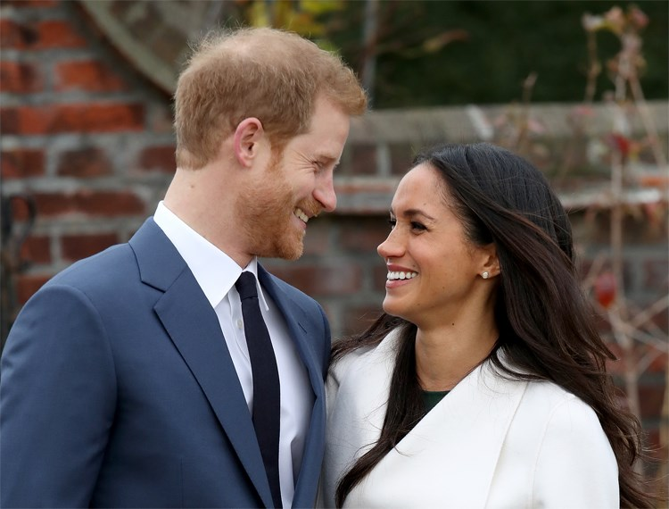 Meghan Markle and woman smiling