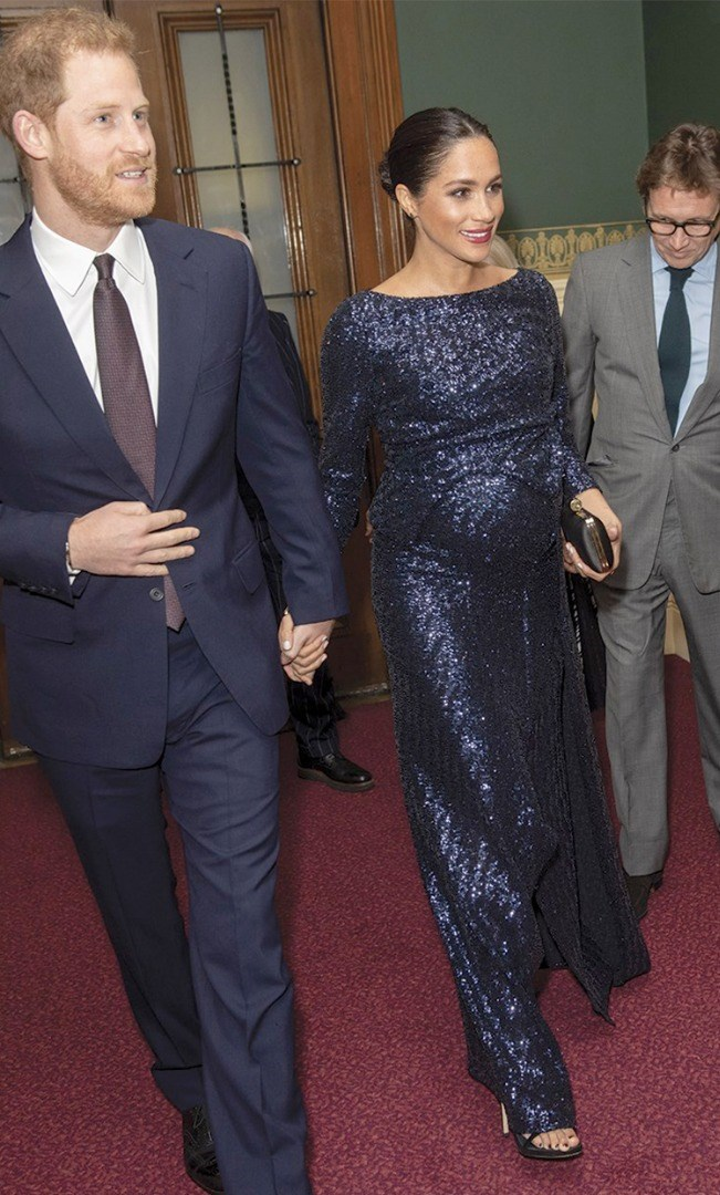 Prince Harry and woman in formal wear
