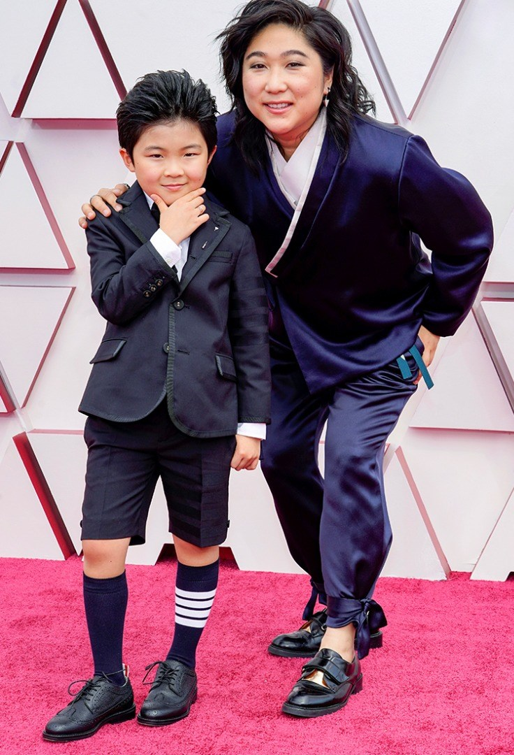 a person and a boy posing for a picture