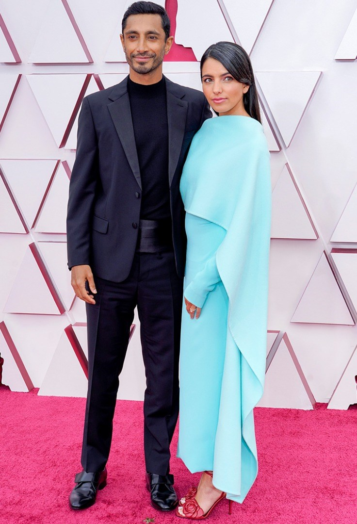 Riz Ahmed and woman posing for a picture