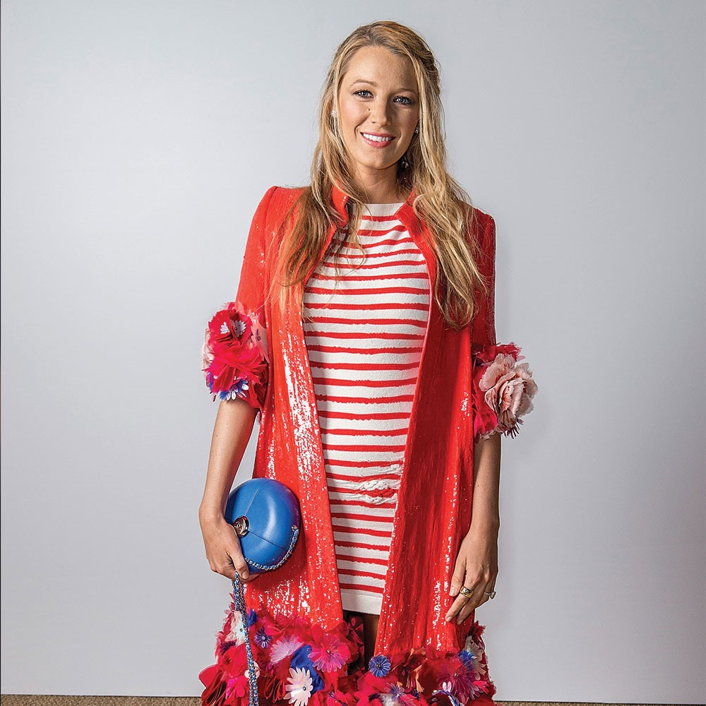Blake Lively in a dress holding a blue ball