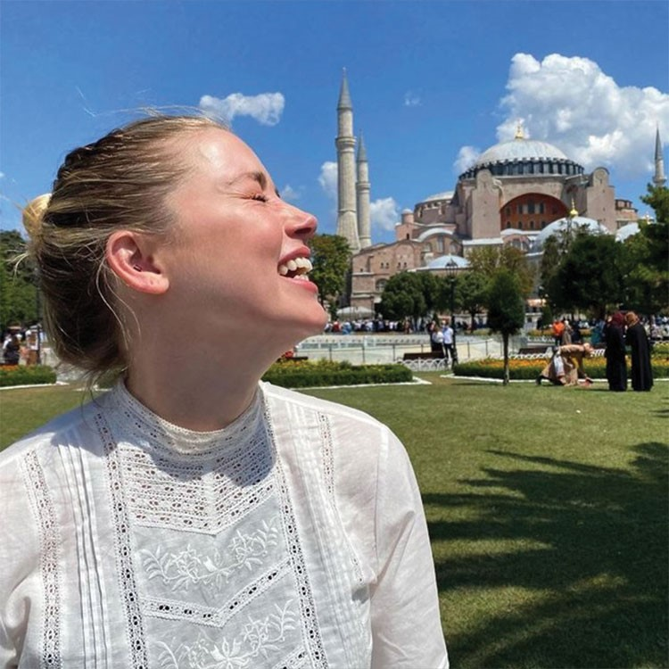 a woman laughing in a park