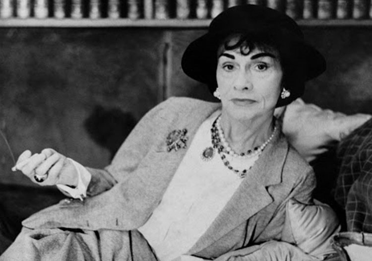 Coco Chanel wearing a hat