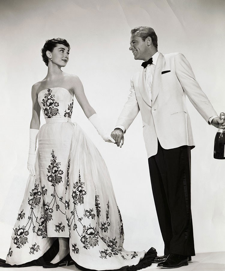 a man and woman in formal wear