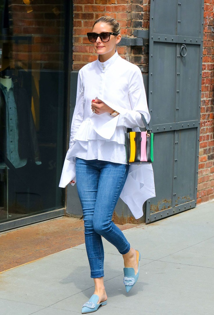 Olivia Palermo wearing sunglasses and a white jacket