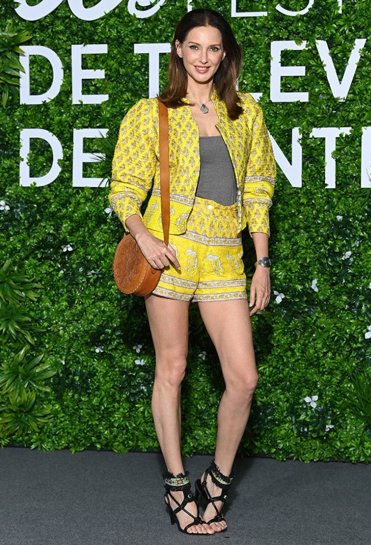 Frederique Bel in a yellow dress